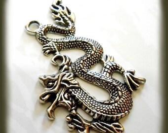 Large antique Silver Dragon pendant
