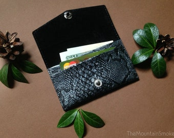 Handmade simple small leather wallet with snake skin facture