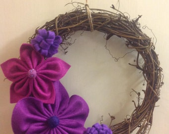 Pretty rattan garland/wreath with Handsewn felt flowers