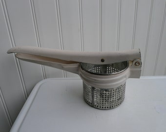 Potato ricer with white coated handle