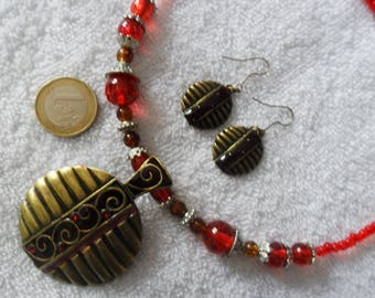 Ornament colors red and bronze beads and pendant and Tibetan Silver earrings