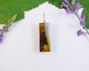 Long wood and resin pendant, lichen coated kauri bark