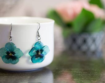 Teal pansy flower earrings. Comes in a gift box.
