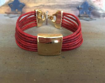 Multistrand Distressed Burnt Red Leather Bracelet with Square Gold Slider Bead and Gold Clasp