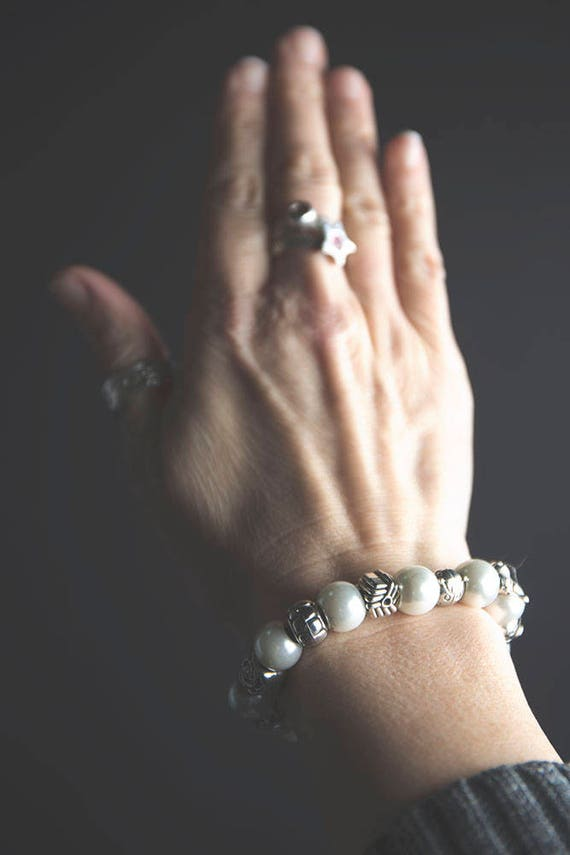 Eliza's Bling - faux pearls and Tibetan silver charms. A bracelet to notice.