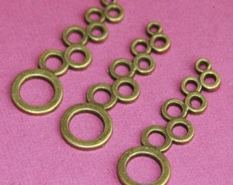 12 pcs of Antique Brass  Circle drops 37x11mm