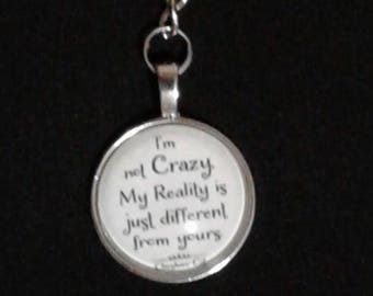 """I'm not crazy. """"My reality is just different than yours"""" Cabochon Glass Pendant on a Silver Plated Key Ring"""
