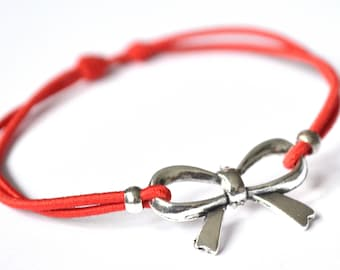 Bow bracelet red cord
