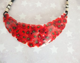 Made entirely of polymer clay poppies, ladybugs and flowers bib necklace. Lady bug poppy flower necklace