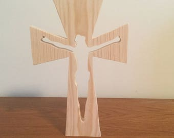 A wooden crucifix with Jesus cutout.