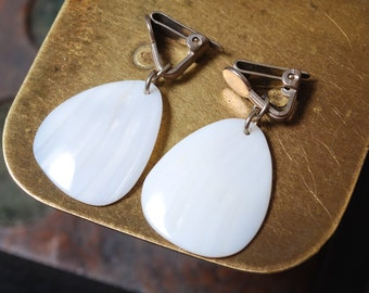 Vintage metal clip of earrings with mother of pearl charms.