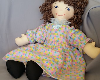 15 inch cloth (rag) doll, with hair and eyes of your choice, comes dressed in multi-colored flannel nightgown