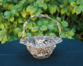 Vintage ornate metal filigree basket with ROSES