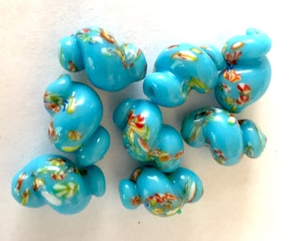 Vintage Japanese beads (8)  glass millefiori little flowers  twist oval snail shape floral turquoise blue 14mm. (8)