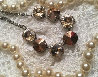 Swarovski 12mm necklace featuring rose gold crystals. Clearly Fabulous!