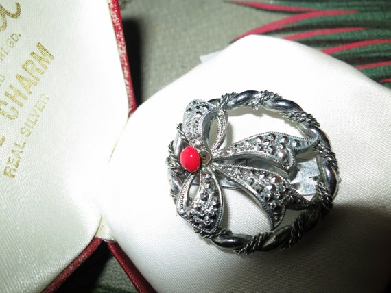 Beautiful Art Deco silver metal marcasite red glass bow design dress clip