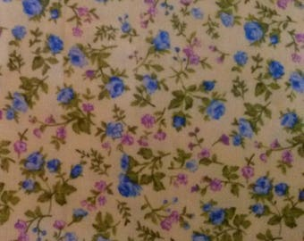 Light yellow floral liberty fabric / patterns flowers blue and purple