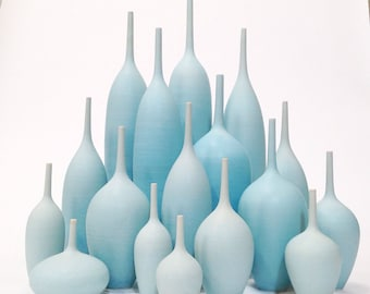 Made to Order -  Grand Collection of 17 stoneware bottle vases in varying shades of ice blue by sara paloma.