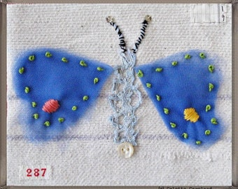 Mini art quilt, winged creature, embroidery, nature