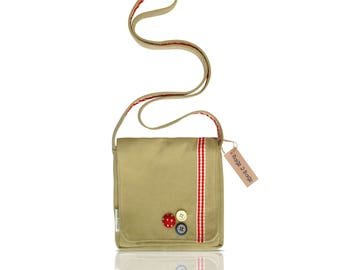 A unique shoulder bag with front fold over flap and ribbon and button detail.