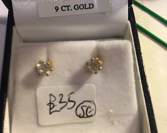 Lovely CZ solitaire stud earrings in 9ct gold claw setting