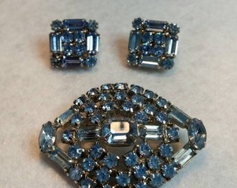 Weiss signed blue rhinestone earrings with unsigned brooch.