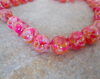 1 lot of 10 pink and khaki glass beads speckled 12mm diameter