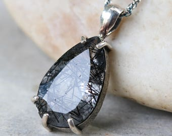 Black rutilated quartz in teardrop shape pendant in silver bezel and polished silver prongs setting/TP