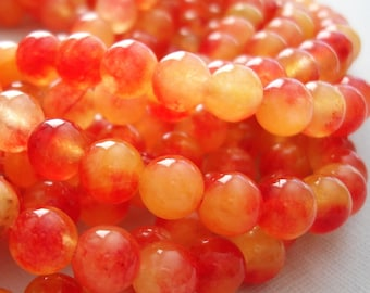 Natural Two Tones Orange Jade Beads - 10mm  - 13.5 inch Strand.