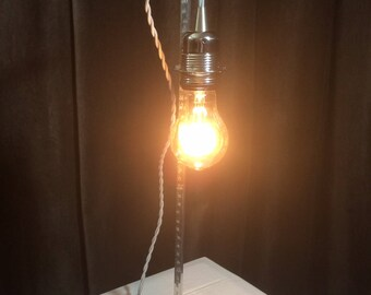 A good height / bulb lamp made from a metal vertical ruler - style Edison