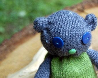 Hand-knitted teddy bear.
