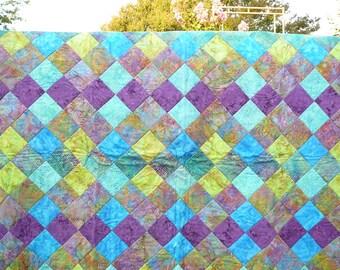 Jewel-tone batik quilt