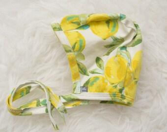 lemon print pilot hat by Little Lapsi. Baby hat with ties.