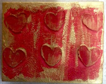 Red and Gold mixed media hearts on canvas