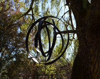 """In Finem"" mobile in oak banding"