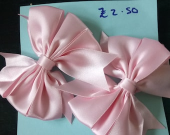 Pale pink bow hair grips