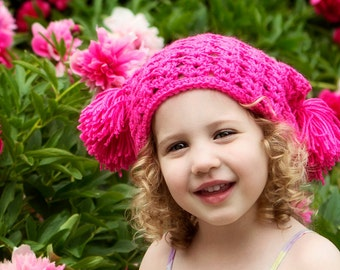 Crocheted textured pom pom hat