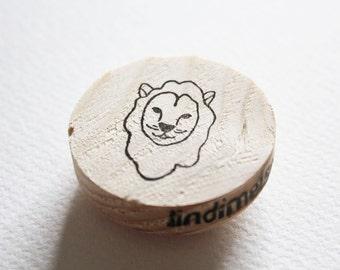 Lion head stamp