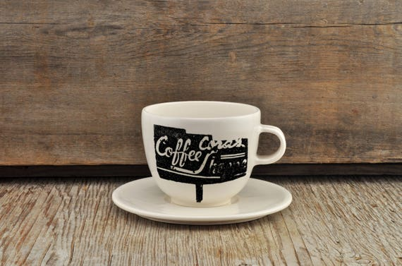 Porcelain coffee cup and saucer with vintage COFFEE SHOP sign
