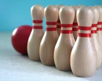 Woodgrain and Red Mini Bowling Set - Pins and Ball In a Starburst Drawstring Bag