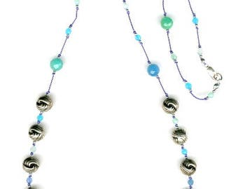 Blue quartz and sterling silver knotted on blue silk necklace