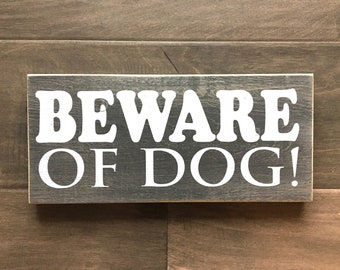 "Beware of dog sign. Sealed for outdoor use. Sign on pine 5.5""x12"""