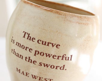Mae West Cup or Mug - The Curve is More Powerful than the Sword