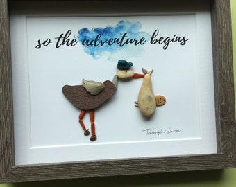 Stork with special delivery pebble art