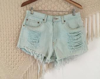 Vintage distressed levis cutoffs, waist 32, womens levis shorts, vintage levis shorts, hipster shorts, festival shorts, distressed denim