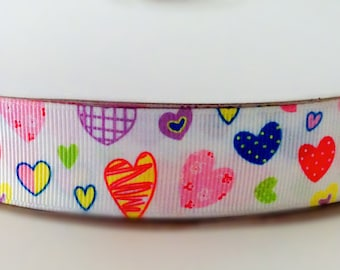 Wide Funky white arty 100% polyester grosgrain ribbon with multi coloured sketched hearts design.