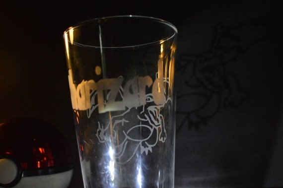 Pick a poke any pokemon pub glass with the poke-name on the back and the # on the bottom
