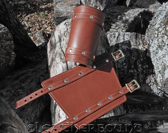 Leather Bracers with hand Carved Grooved Accent lines in Chestnut Brown.