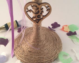 Burlap flower and wooden heart twine wrapped champagne flute