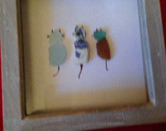 Unique handmade sea glass and pottery cats in a box frame